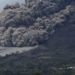 Mount Sinabung volcano spews ash during an eruption, as seen from Berastepu village in Karo district, Indonesia's North Sumatra province